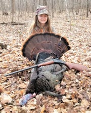 Kaylee Marquardt of Francis Creek shows the tom she harvested during the Learn to Hunt turkey program sponsored by the Maribel Sportsmen's Club. The big tom tipped the scale at 21 pounds, 6 ounces, had a 10-1/2-inch beard and 3/4-inch spurs.