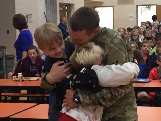 U.S. Army Spc. Shelby Dininger, a 2009 graduate of Lexington High School, surprised his two sons, Austin, 10, and Austin, 7, at Stingel Elementary School Monday. Dininger has been away nine months on a deployment in the Middle East.