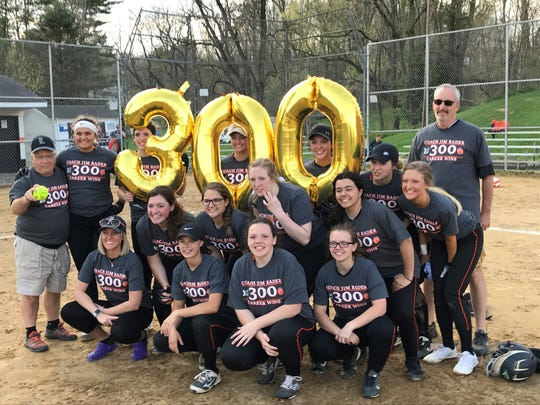 The Lucas Lady Cubs pose with head coach Jim Rader (Far left, back row) after he earned his 300th career victory and 100th at Lucas last week.