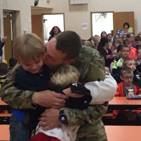 Father surprises sons at grade school after 9-month deployment
