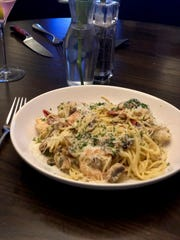 The Elfo's Special at Ronnie Grisanti's. Shrimp are sauteed in butter and garlic and tossed with thin vermicelli pasta.