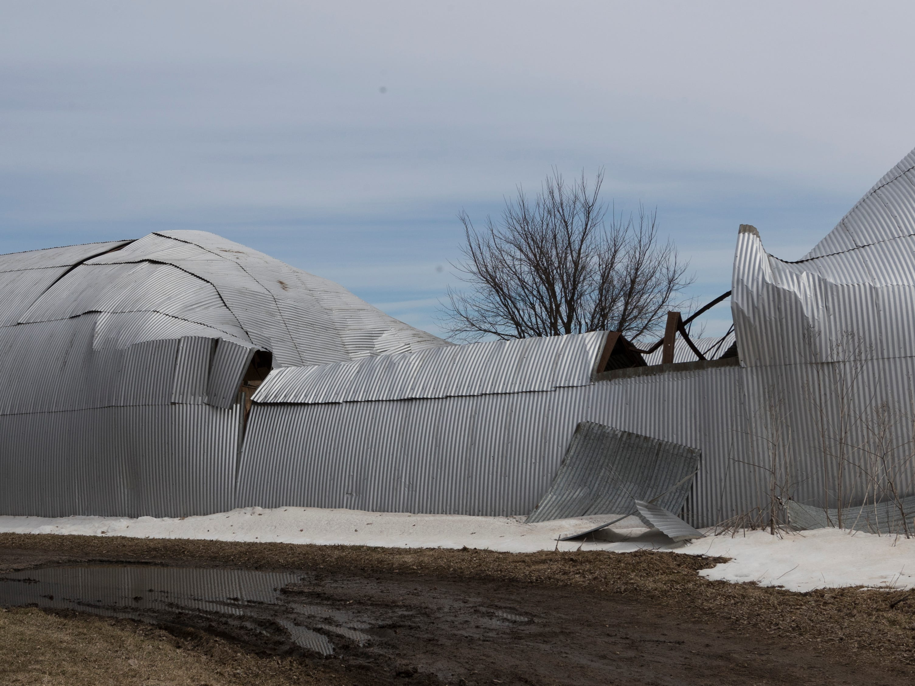Bruce Drinkman's collapsed machine shed at his farm in Ridgeland.