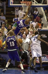 Milwaukee Bucks guard Ray Allen dunks over Tracy McGrady with 3.5 seconds left to force overtime in Game 3 of the 2001 NBA playoff first-round series at TD Waterhouse Centre Arena in Orlando, Florida. The Bucks lost 121-116