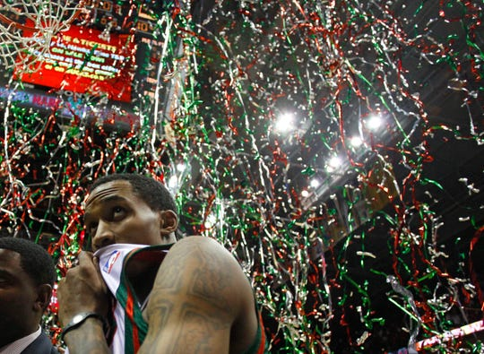 Milwaukee Bucks' Brandon Jennings is showered with confetti after Game 4 of a first-round NBA basketball playoff series against the Atlanta Hawks, Monday, April 26, 2010, in Milwaukee.  Jennings lead his team with 23 points in their 111-104 win.