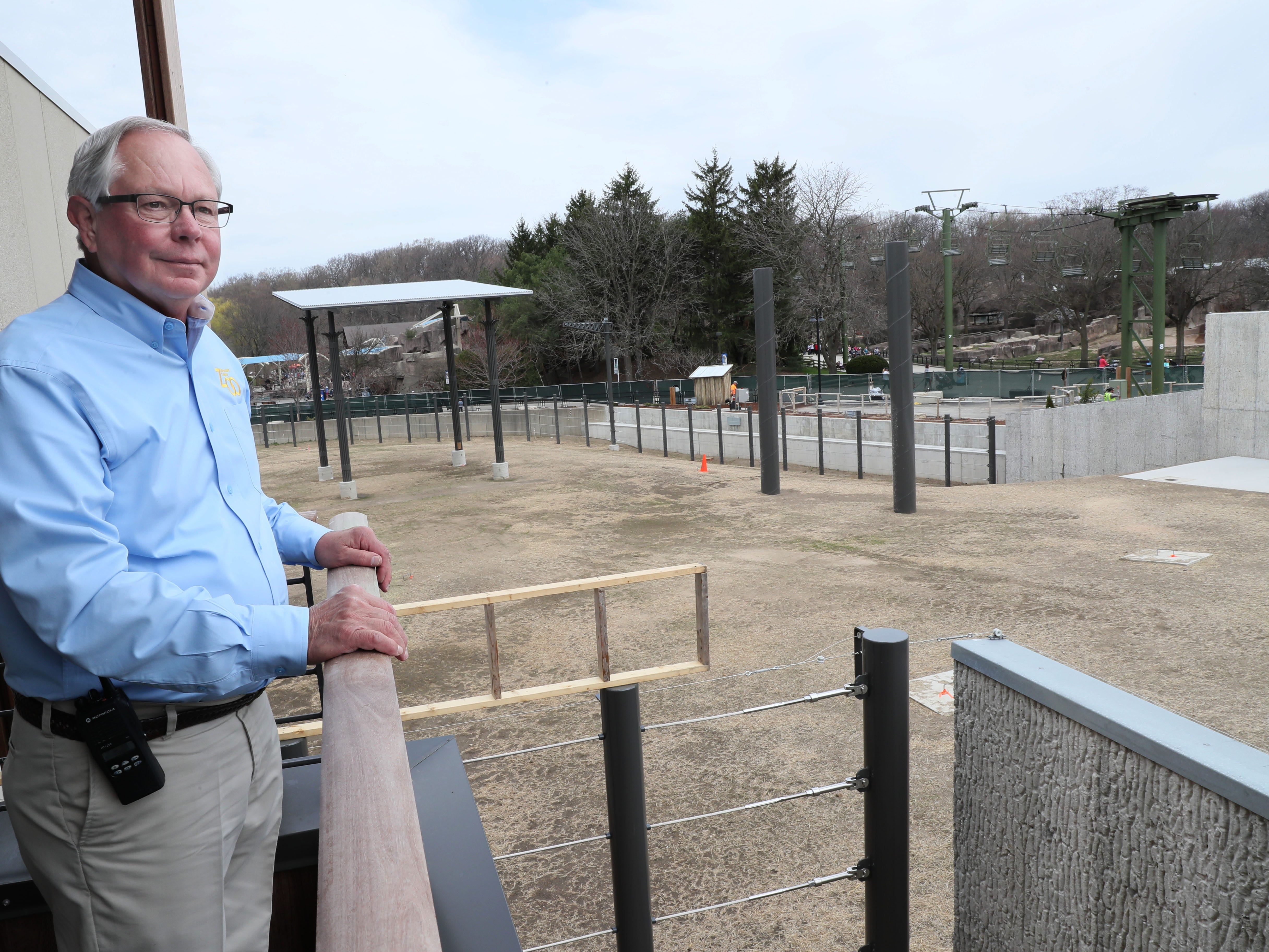 Zoo Director Chuck Wikenhauser looks over a portion of the elephant's outdoor space.