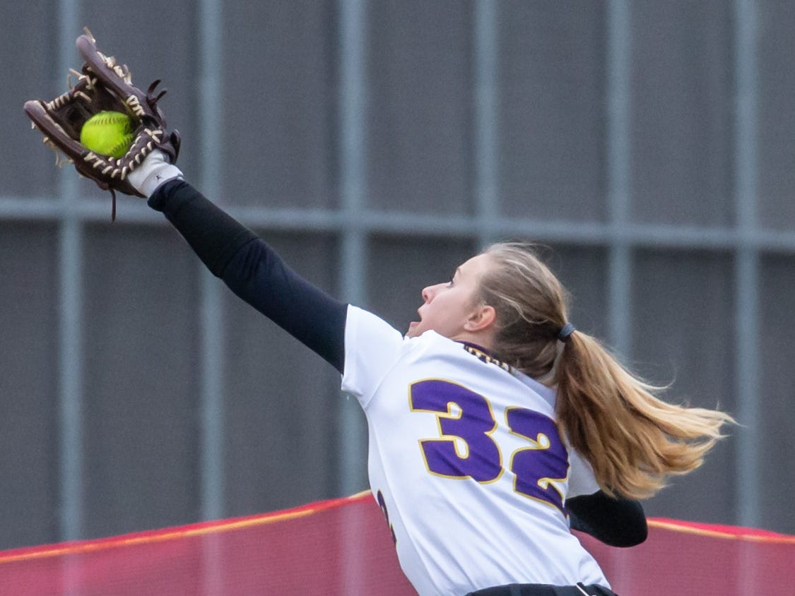 Cudahy left fielder Matisen Verley (32) snags a fly ball during the game at Pewaukee on Thursday, April 18, 2019.