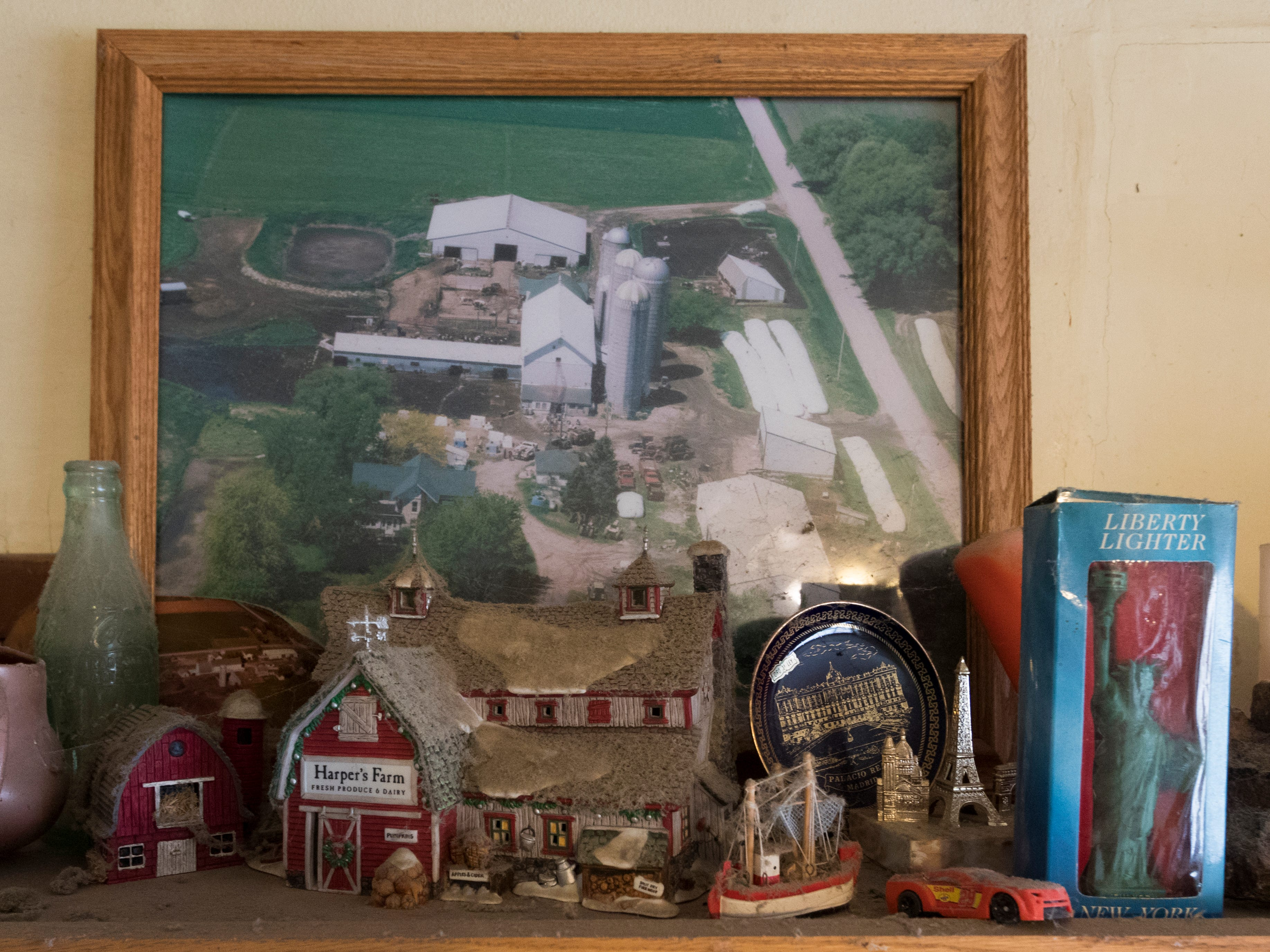 Mementos surround a photo of the Mess family farm in the kitchen.