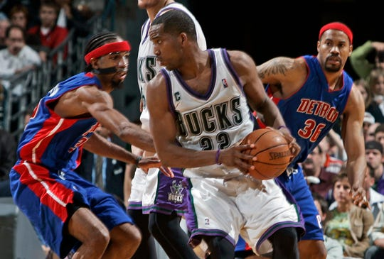 Milwaukee Bucks'  Michael Redd gets pressure from Detroit Pistons' Ben Wallace and Rasheed Wallace at the Bradley Center Monday, May 1, 2006.