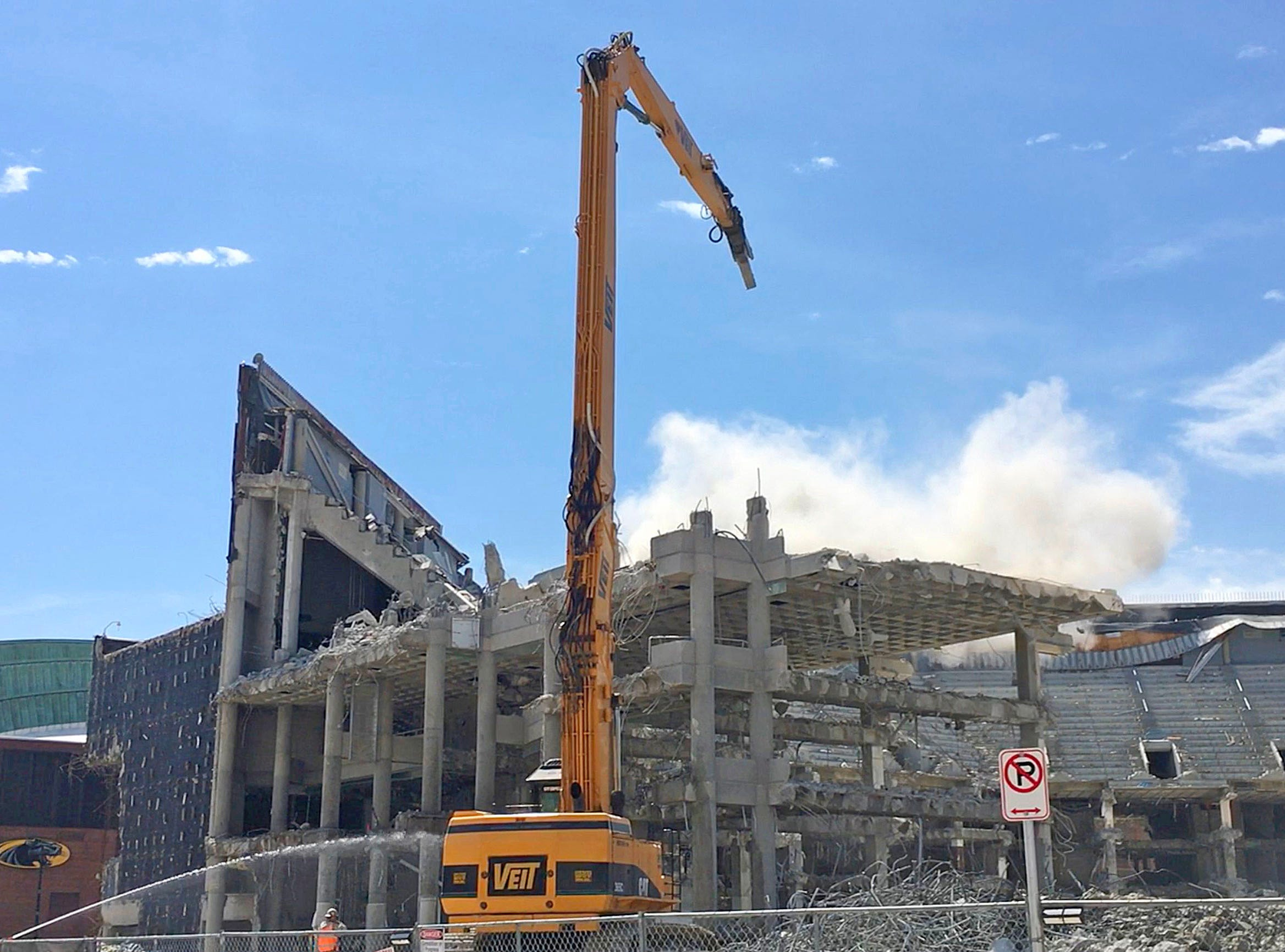 Dust settles as a beam from the upper bowl of the arena comes crashing down.