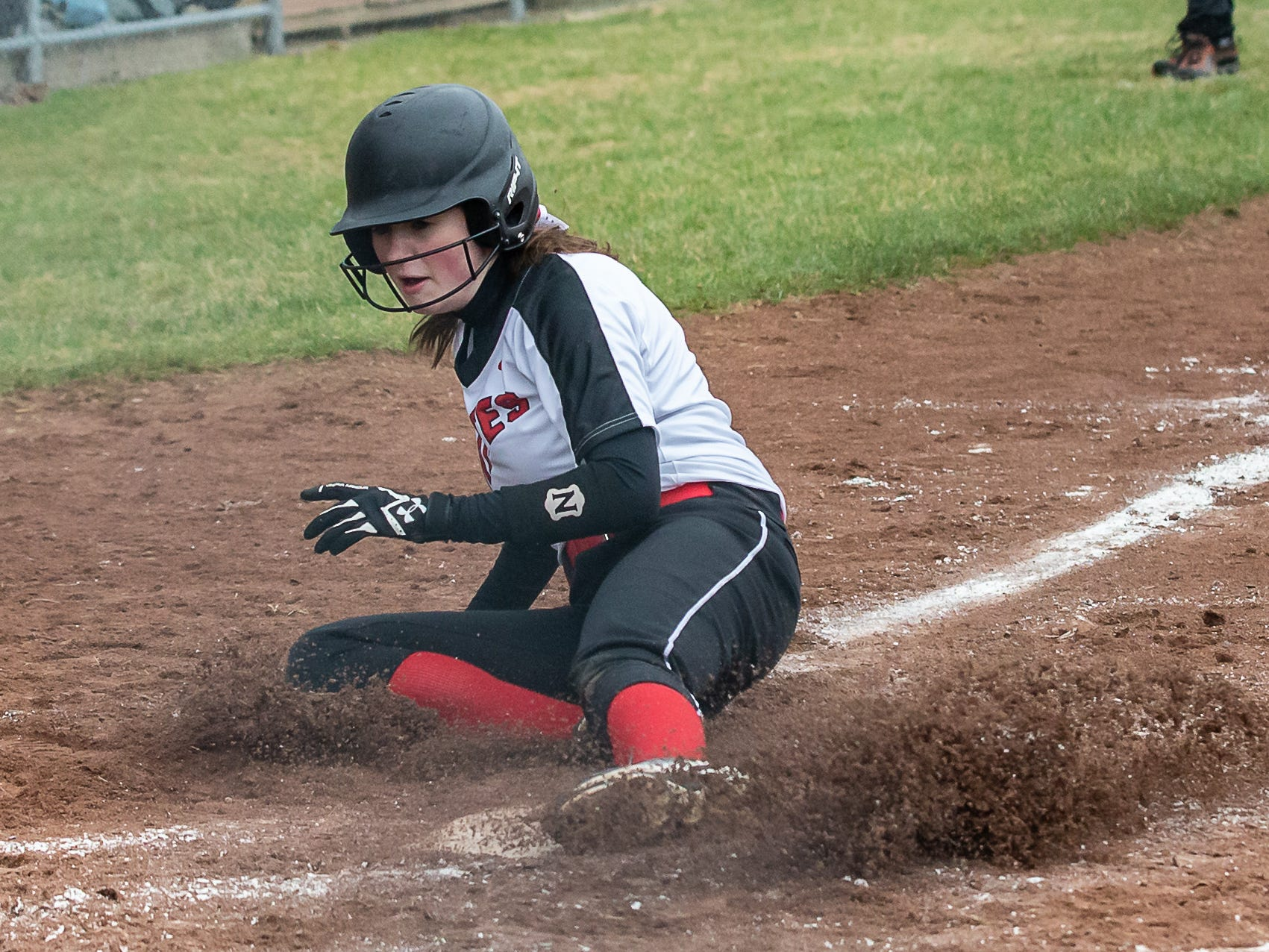Pewaukee's Jenna Brandl (15) slides in safe during the game at home against Cudahy on Thursday, April 18, 2019.