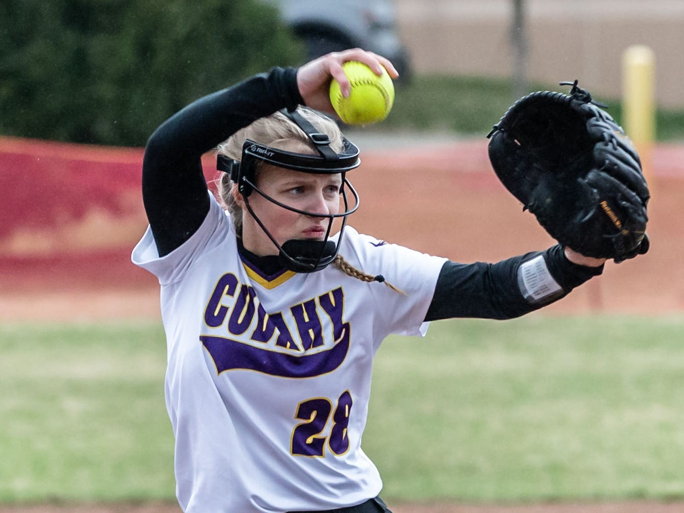 Cudahy's Makayla Bishop (28) delivers a pitch during the game at Pewaukee on Thursday, April 18, 2019.