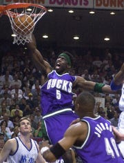 Milwaukee Bucks' Tim Thomas scores with a jam during the second period of game 3 of their NBA Playoffs game Saturday, April 28, 2001, at the TD Waterhouse Centre Arena in Orlando, Florida.