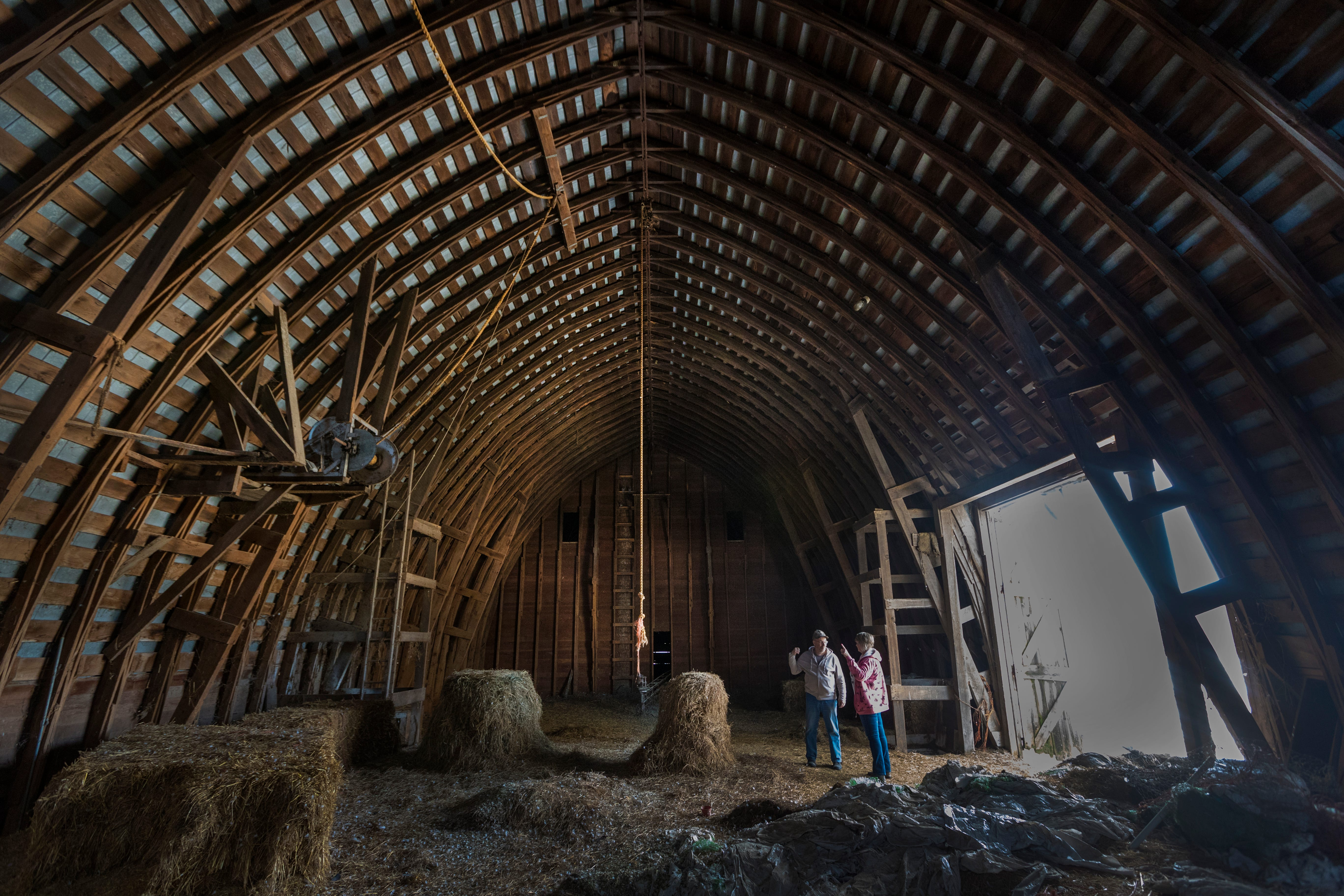 Bruce Drinkman and his companion, Betty Jo Johnson, stand in the hayloft designed to hold about 10,000 bales of hay at the farm in Ridgeland. Drinkman, a former dairy farmer, purchased this small farm in Dunn County.