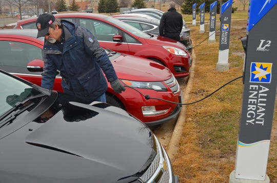 Fran Mara, Alliant Energy employee, charges a vehicle at Alliant Energy Corp.'s headquarters in Madison in 2016.