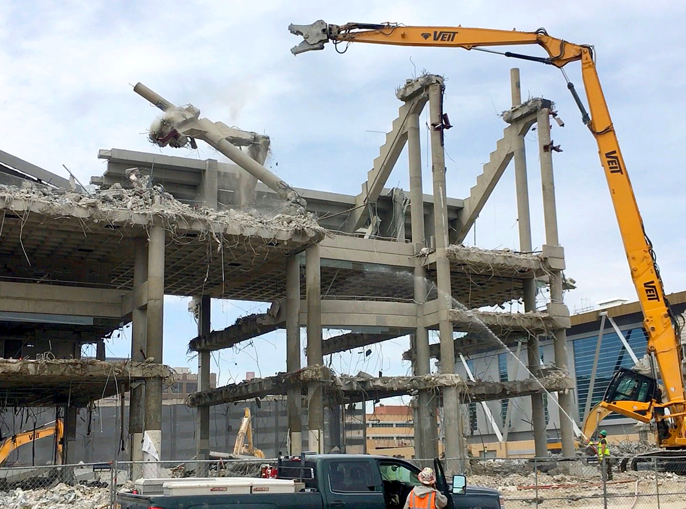 A beam from the upper bowl of the arena comes crashing down as work continues.