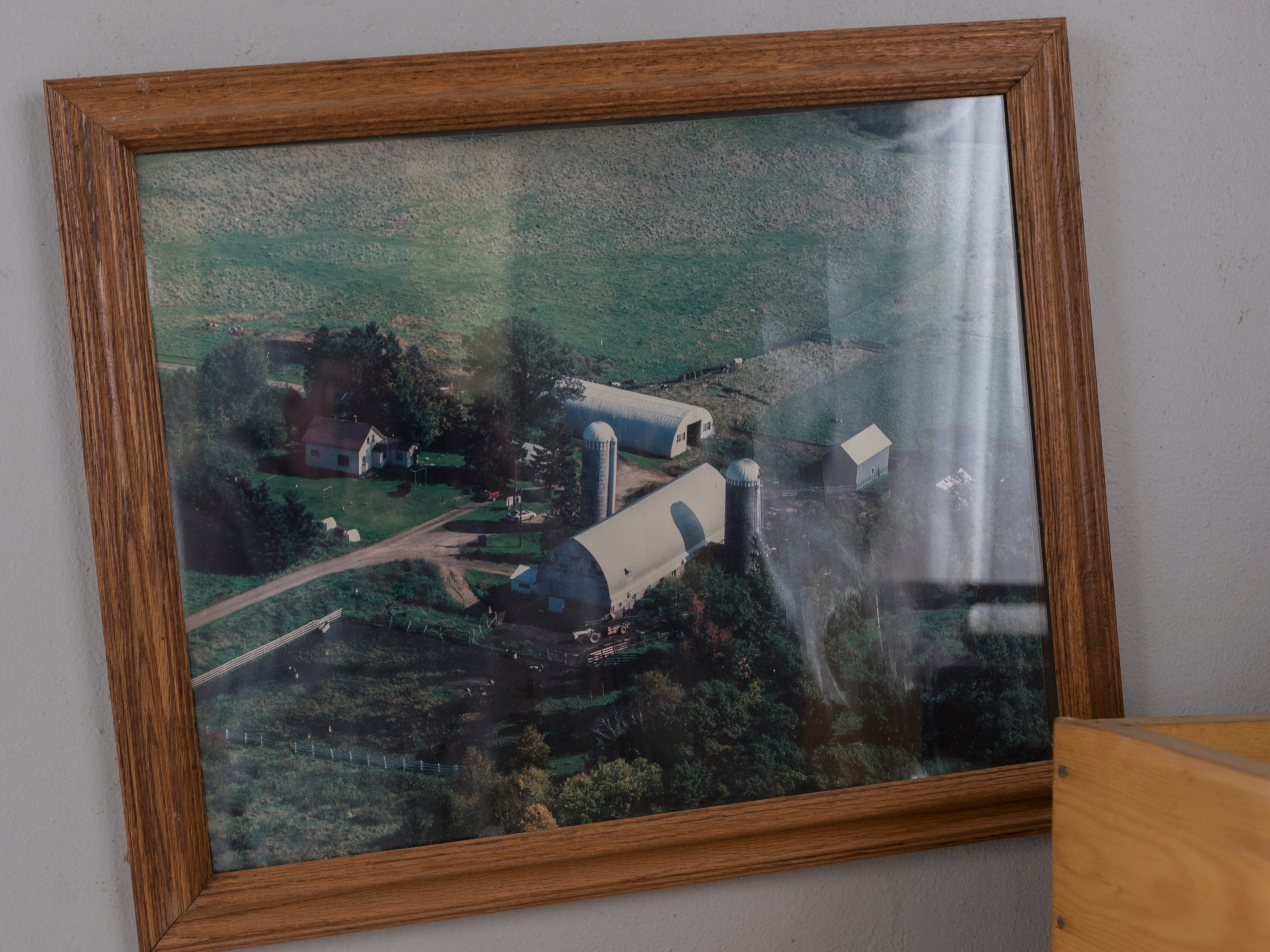 An old aerial photo still hangs in the abandoned farmhouse.