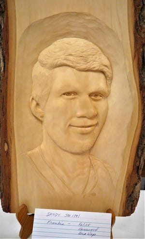 This work by Sandy Smith is one of this month's featured carvings of the North Arkansas Woodcarver's Club. The NAWC'sThursday meetings havefeaturedvarious types of carvings on display, including relief, wood burning, caricatureand chain saw carvings. The woodcarvers meet on Thursday mornings at the Mountain Home VFW Post 3246, just west of the fire station on the corner of Seventhand Gray streets. Anyone interested in woodcarving can stop by the VFW or visit the Baxter County Fair Grounds in May.