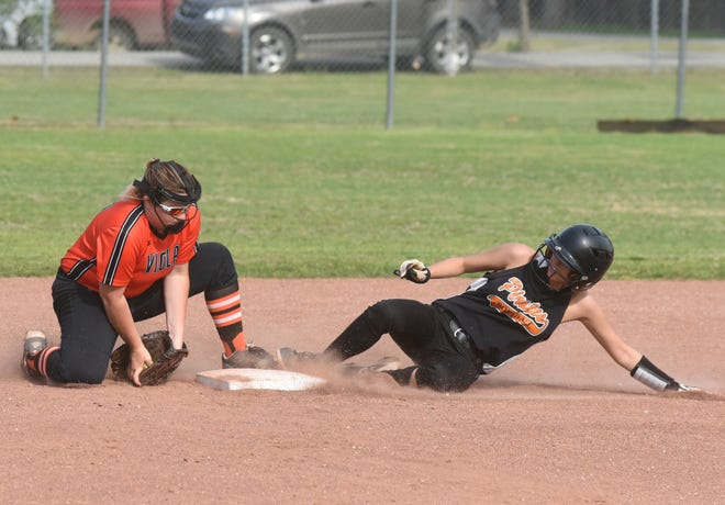 Viola's Karsyn Perryman takes the throw as Calico Rock's Kaylee Pool slides into second base on Monday at Viola City Park.