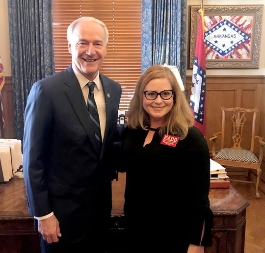 Michele Paden (right) of Mountain Home, President of Families Against Distracted Driving, is pictured with Arkansas Governor Asa Hutchinson at the state capitol on April 9. Paden founded F.A.D.D. in 2015 to spread awareness about the dangers of distracted driving after her nephew was left paralyzed by a distracted driver. Paden delivered presentations on the dangers of distracted driving to schools, civic clubs and community events throughout the state, while also testifying before the General Assembly in 2015, 2017 and 2019. Paden and F.A.D.D. were commended for their work by the Arkansas State Senate via a Senate Resolution.