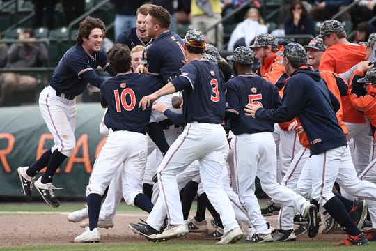 Auburn players celebrate a walk-off win over Ole Miss on April 20, 2019.