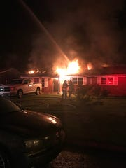 Firefighters battle a house fire in the 2600 block of Westwood Drive.