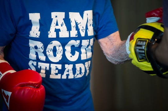 Jack Noble's Rock Steady boxing shirt as he runs through drills during a Rock Steady boxing class at MetroFitness in Montgomery, Ala., on Monday, April 22, 2019.