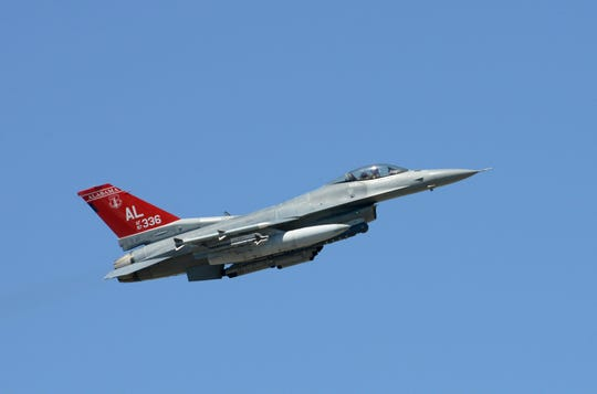 A U.S. Air Force F-16 Falcon assigned to the 100th Fighter Squadron, 187th Fighter Wing, Alabama Air National Guard with the unit's distinctive 'Red Tail' takes off on an afternoon sortie from the Air Dominance Center at the Savannah Air National Guard Base, Savannah, Georgia, April 16, 2019.