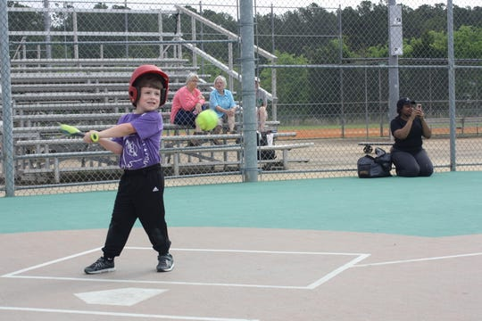 Miracle League player Stryder swings away during a League game.