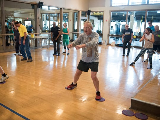 Students and trainers do a warm up exercise  during a Rock Steady boxing class at MetroFitness in Montgomery, Ala., on Thursday, April 18, 2019.