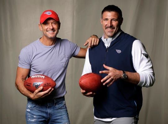 In this April 18, 2019, photo, country music star Tim McGraw, left, poses with Tennessee Titans head coach Mike Vrabel in Nashville, Tenn. After the opening round of the NFL Draft in Nashville on Friday, April 25, McGraw will cap off the evening performing on the draft stage across the Cumberland River from Nissan Stadium, home of the Tennessee Titans.