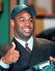 Former Syracuse quarterback Donovan McNabb gives a thumbs up as he poses for the media after the Philadelphia Eagles made him team's first pick, second overall, in the NFL Draft April 17, 1999 in New York.