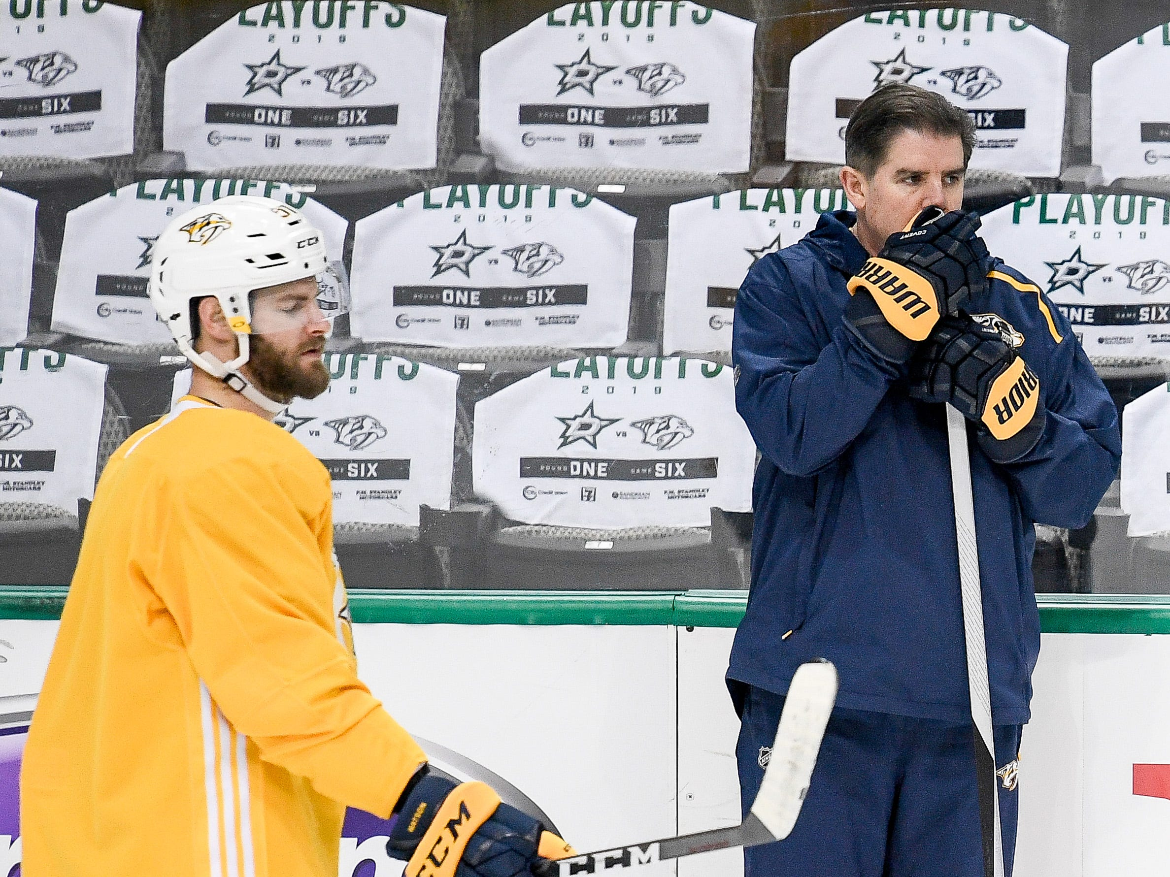 Nashville Predators head coach Peter Laviolette keeps an eye on his team during practice before the divisional semifinal game against the Dallas Stars at the American Airlines Center in Dallas, Texas, Monday, April 22, 2019.