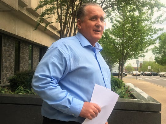 John Polston walks out of the federal courthouse in Nashville on April 18 after his first court appearance. Polston, the pharmacist in charge at Dale Hollow Pharmacy in Celina, was indicted on 21 counts of illegally dispensing Schedule II and Schedule IV controlled substances.