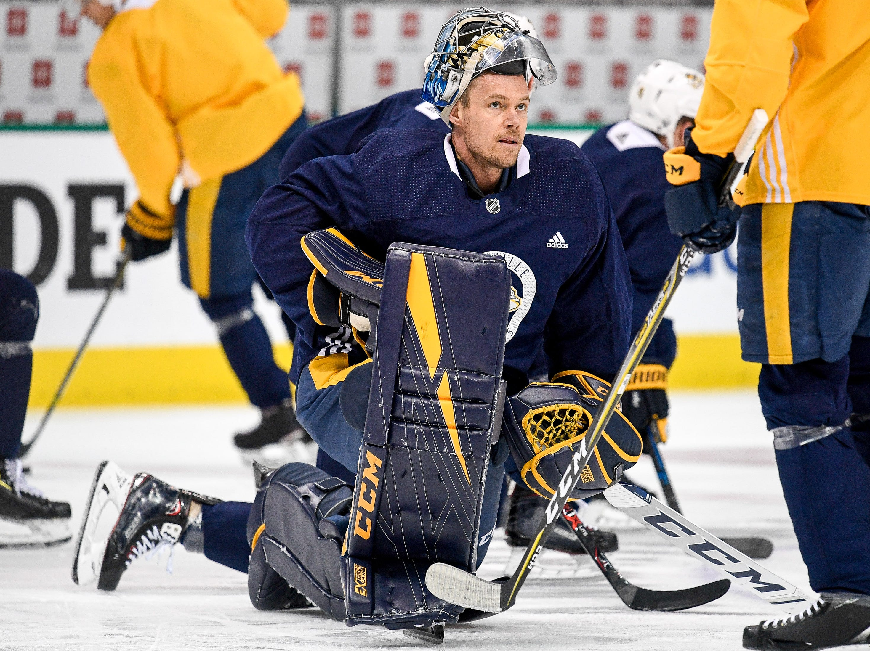 Nashville Predators goaltender Pekka Rinne (35) chats with teammates during practice before the divisional semifinal game against the Dallas Stars at the American Airlines Center in Dallas, Texas, Monday, April 22, 2019.