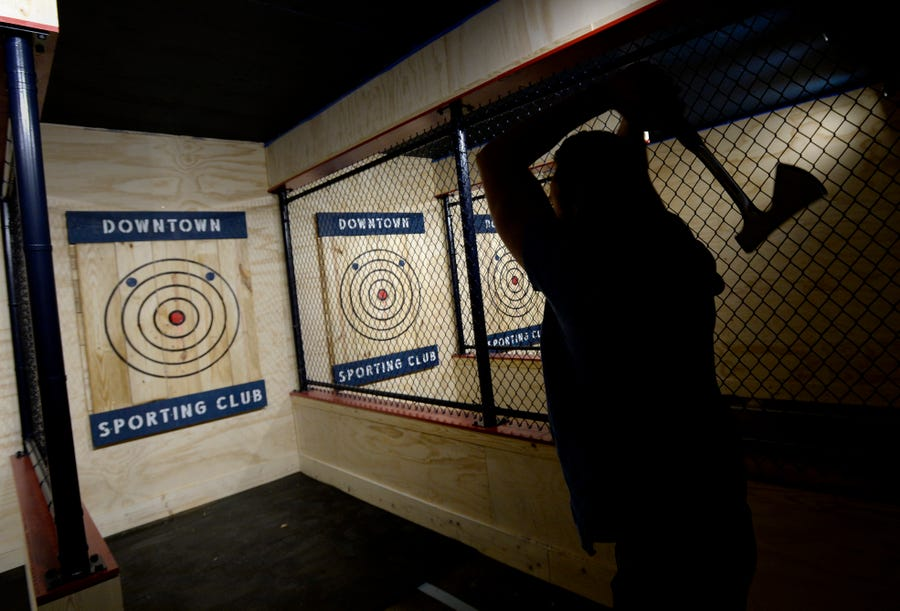 Nashville restaurateur Max Goldberg demonstrates how to throw an ax inside the new Downtown Sporting Club on Monday, April 22, 2019 in Nashville, Tenn. The massive Downtown Sporting Club is on Lower Broadway and opening this week before the NFL Draft. It will include a restaurant, coffee shop, boutique lodging and an ax throwing area.