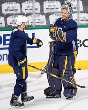 Nashville Predators goaltender Pekka Rinne (35) fist bumps defenseman Matt Irwin (52) during practice before the divisional semifinal game against the Dallas Stars at the American Airlines Center in Dallas, Texas, Monday, April 22, 2019.