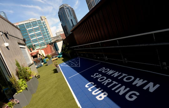 The Downtown Sporting Club roof top and bar area on Monday, April 22, 2019 in Nashville, Tenn. The massive Downtown Sporting Club, owned by Max and Ben Goldberg, is on Lower Broadway and opening this week before the NFL Draft. It will include a restaurant, coffee shop, boutique lodging and an ax-throwing area.