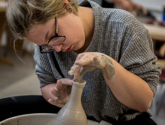 Newark senior, Jazmin Harkin works on a ceramics piece in her ceramics class at the high School. One of Harkin's other pottery pieces has received  top honors at the Governor's Art  Show.