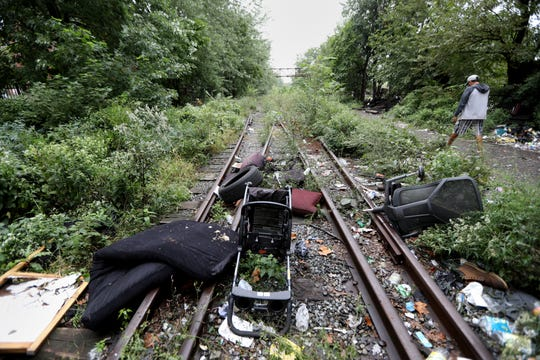 Trash and overgrown vegetation are predominately what you see along the train tracks in Passaic between Pulaski and Dundee Island Park. Fadi Sanaan (right) said he did not know he was purchasing the land when he bid on a two acre piece of land just south of this strip of land. Wednesday, September 26, 2018