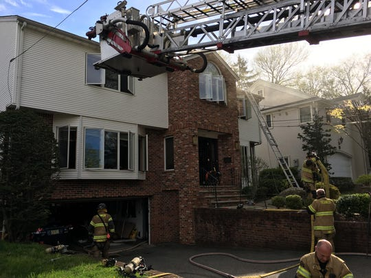 Firefighters at the scene of a fire at a Maitland Avenue home.