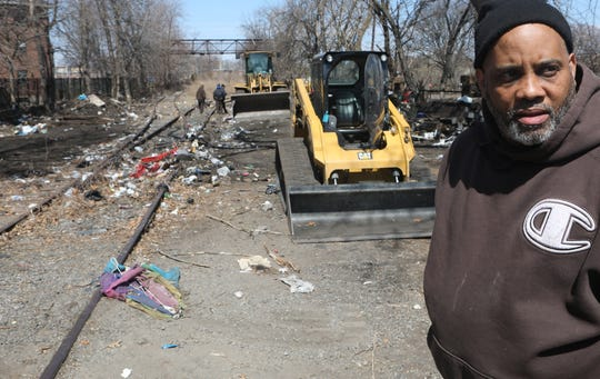 Kasim Washington, of the Passaic DPW, is shown, Thursday, April 4, 2019. An area, near the intersection of Wall and 6th St. in Passaic, known as an area where people come to do drugs and prostitution, is being cleaned by the city. Thursday, April, 4, 2019