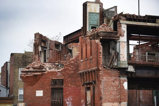 Photo of the back of the remaining facade area of the Paterson Armory during its demolition in Paterson on 04/22/19. The armory was once a vibrant community hub that was vacant for decades before much of it was destroyed in a 2015 fire.