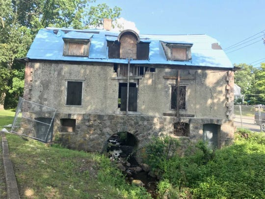 Oakland's Stream House was built by Edward Page in 1902 with an arch over  Pond Brook to provide a natural source of cooling for his dairy farm's products in the basement.