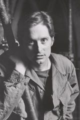 "Michael Douglas in The American Place Theater production of George Tabori's ""Pinkville,"" about the My Lai Massacre in Vietnam. Douglas credits acting teacher Wynn Handman with giving him the confidence to pursue acting.  He won a 1971 Theatre World Award for his portrayal of Jerry the Naz in the play."