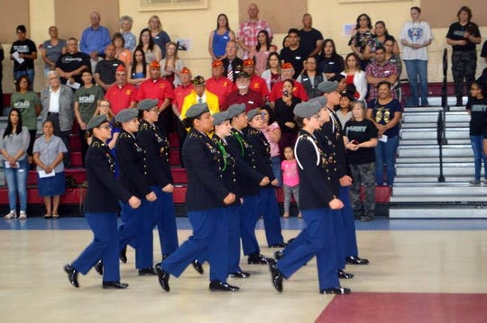 The Deming High School JROTC Wildcat Battalion performed a drill routine during the annual Bataan Death March tribute at Bataan Elementary School.