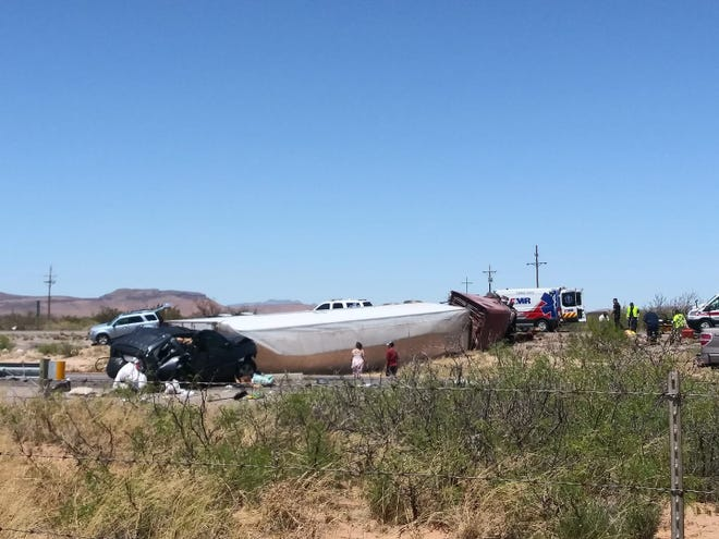A semi-truck collided with Jeep towing a U-Haul truck Sunday, April 21, 2019 west of Las Cruces and flipped on its side. Both the east and westbound lanes of Interstate 10 near milepost 129 were closed, and traffic was diverted onto the frontage road, according to New Mexico State Police.