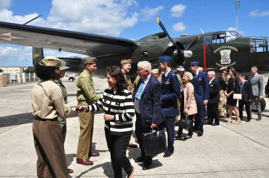 """The family of retired Air Force Lt. Col. Richard """"Dick"""" E. Cole look at a B-25 Mitchell static display during a memorial service for their father at Joint Base San Antonio-Randolph, Texas, April 18, 2019. Cole, the last surviving Doolittle Raider, was the co-pilot on a B-25 Mitchell for then Col. Jimmy Doolittle during the storied World War II Doolittle Tokyo Raid."""