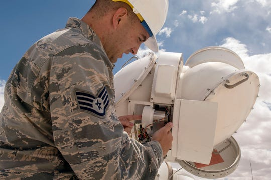 Staff Sgt. Bradley Douglas, 2d Weather Squadron, Detachment 4, central repair activity technician performs an inspection of a declination head April 11, 2019, at the Solar Observatory on Holloman Air Force Base, N.M. The inspection involves verifying the wires are still serviceable and properly connected to the drive gear assembly and gear tachometer.