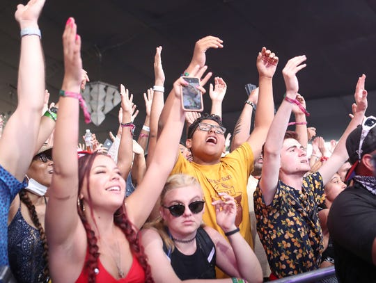 Fans watch Lizzo perform at the Coachella Valley Music and Arts Festival in Indio, April 21, 2019.