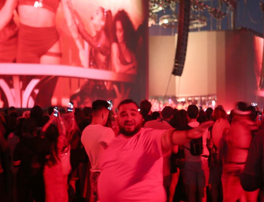 Fans enjoy the musical stylings of Ariana Grande at the Coachella Valley Music and Arts Festival in Indio, April 21, 2019.